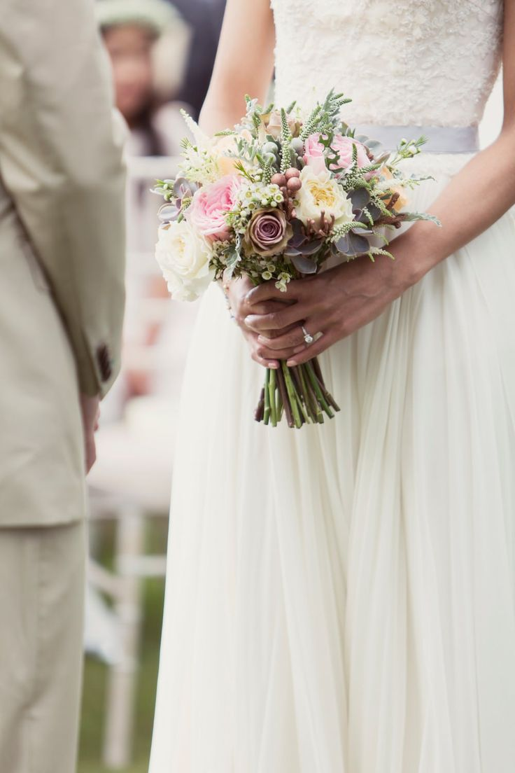 Image by Craig & Eva Sanders Photography - Bride in a Bespoke Gown with Gold Christian Louboutin Shoes, for an outdoor humanist ceremony in Wales with pastel colour scheme & copper hints.