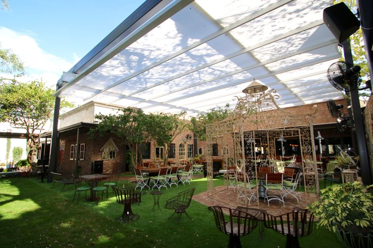 SEFAR Tenara Fabric covered the 46' x 38' courtyard with a retractable and translucent membrane