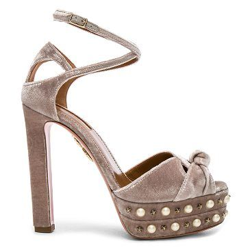 Velvet Harlow Pearls Plateau Heels by Aquazzura. Velvet upper with leather sole.  Made in Italy.  Approx 40mm/ 1.5 inch platform.  Approx 125mm/ 5 inch heel.  Wrap around ankle strap with buckle closure.  Front and back cut out detail.  Knot accent.  Pearl and star stud trim. #aquazzura #nudeshoes #sandals
