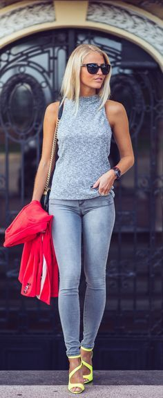 grey fitted crop top, grey skinny jeans and yellow asymmetric stilettos