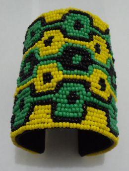 "Jamaica inspired beaded cuff bracelet....length is 3"" long."