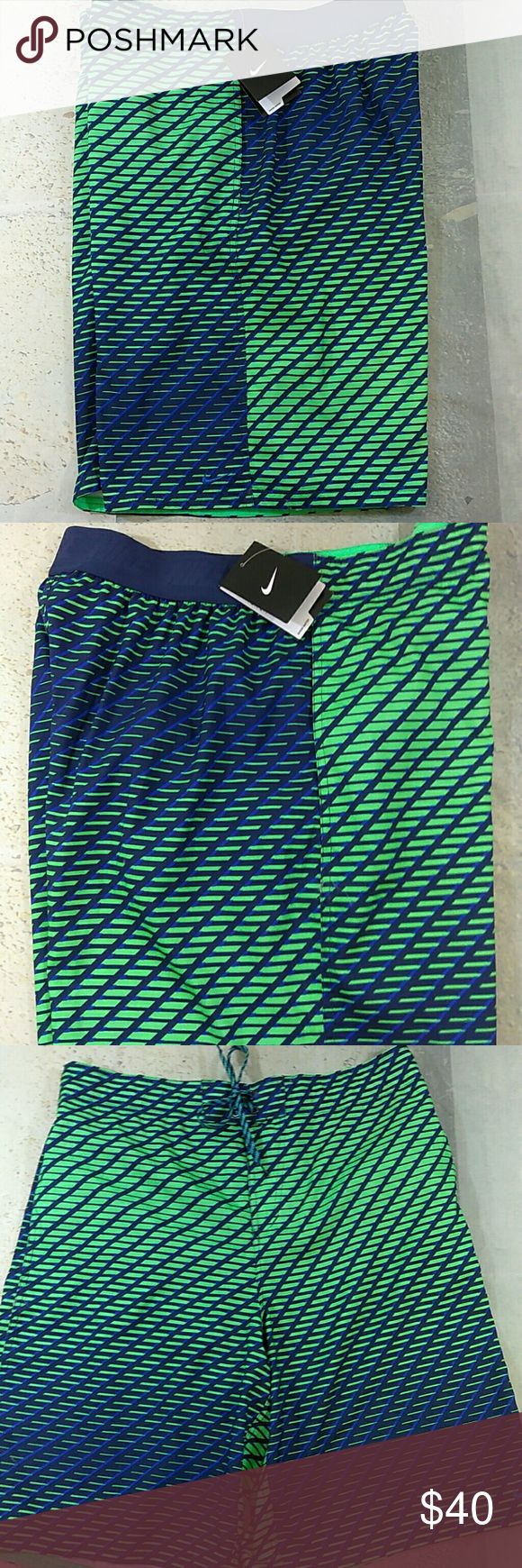 """Men's Nike Board Shorts Swim Trunks XL Men's Nike Board Shorts  Blue Green Size: XL  Waist: 36"""" (Unstretched) Inseam: 11""""  Mesh Brief  Back half has smooth elastic band  Tie Front, Side Pockets  New, with tags. Thank you! Nike Swim Board Shorts"""