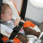flying with baby, flying with newborn, baby's first flight, car seat on plane, flying with an infant, travelling with baby