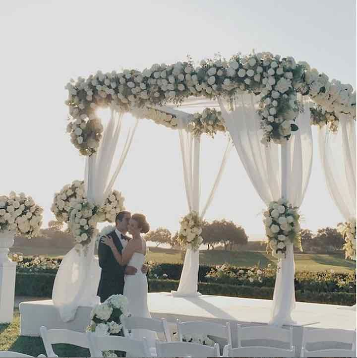 elegant outdoor wedding ceremony with white flowers; via Details Details Wedding and Event Planning