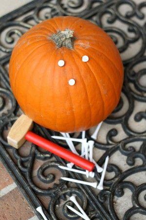 Pounding Golf Tees into a Pumpkin (illuminate afterwards)