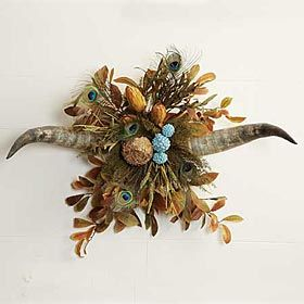 DOUBLE HORN ARRANGEMENT   +++    These beautiful hand crafted pieces include an array of vibrant dried silk, Peacock feathers and natural floral artfully placed in naturally shed horns. Can be displayed on a tabletop or hung on the wall.