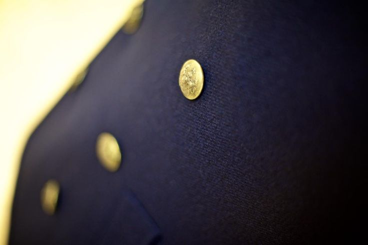 The buttons on this Naval Pea Coat are antique, from one of the Queen`s household regiments.