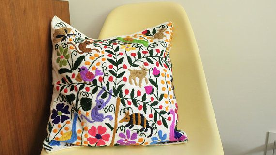 "This is an original hand-made embroidered pillow cover crafted by indigenous artisans group in Chiapas, Mexico. The pattern inspired to the nature and the colorful canvas reflect traditional mexican culture. Women from Chiapas region are famous worldwide for their ""bordados"""
