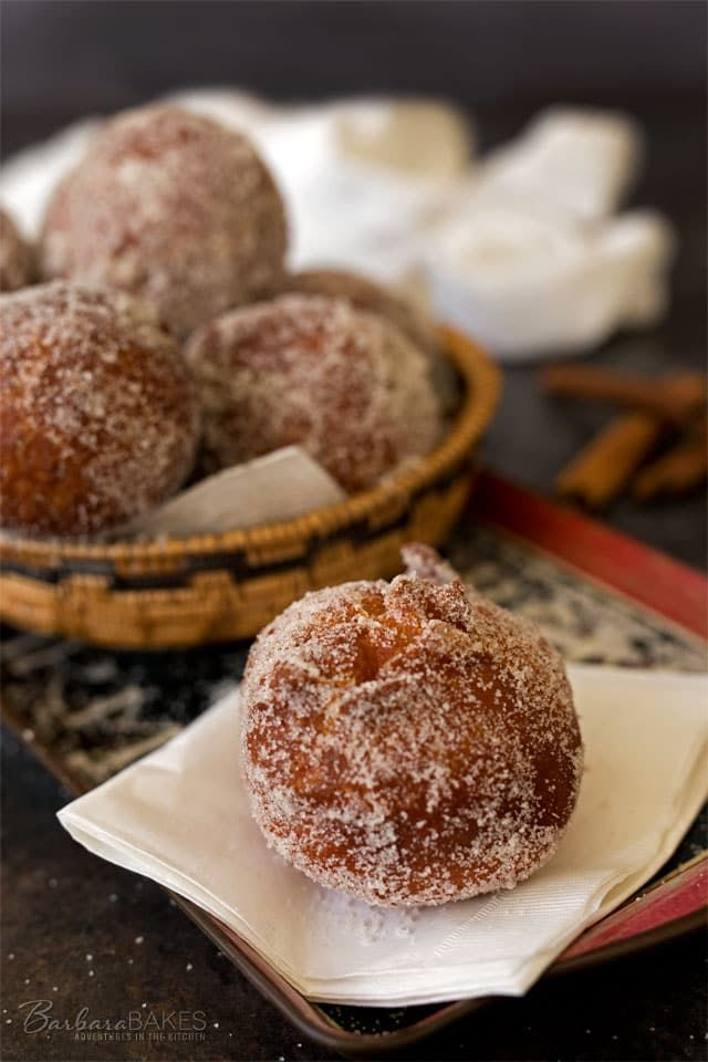 Easy, fun-to-make Cinnamon Sugar Malasadas. Hawaiian donuts made with a rich buttery dough, served hot from the fryer rolled in cinnamon sugar.