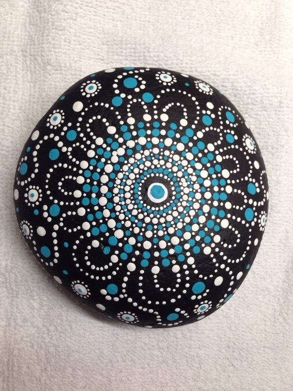Hand painted dot art stone has the blues