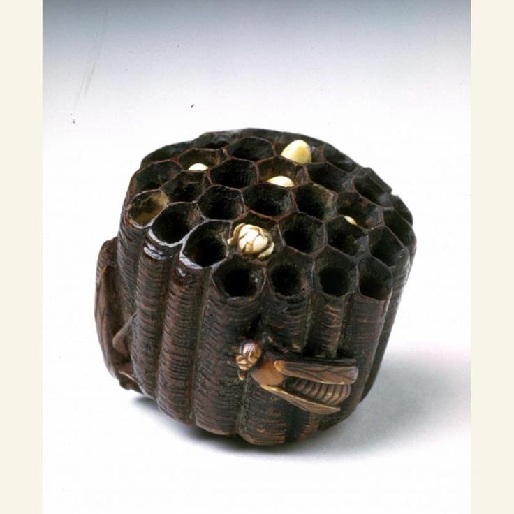 Designation: Wasp's nest with two wasps  Object Name: Netsuke  Date: 1800-1900  Medium: Stained wood, ivory
