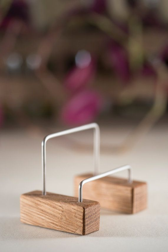 Our Skijor modern business card holder features a minimalist design that is at once elegant and eco-friendly. Reclaimed bike spokes connect to