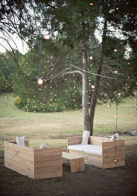 Outdoor Sofa via: style-files.com Fairy lights in the trees and beautiful wood and white outdoor furniture setting. <3