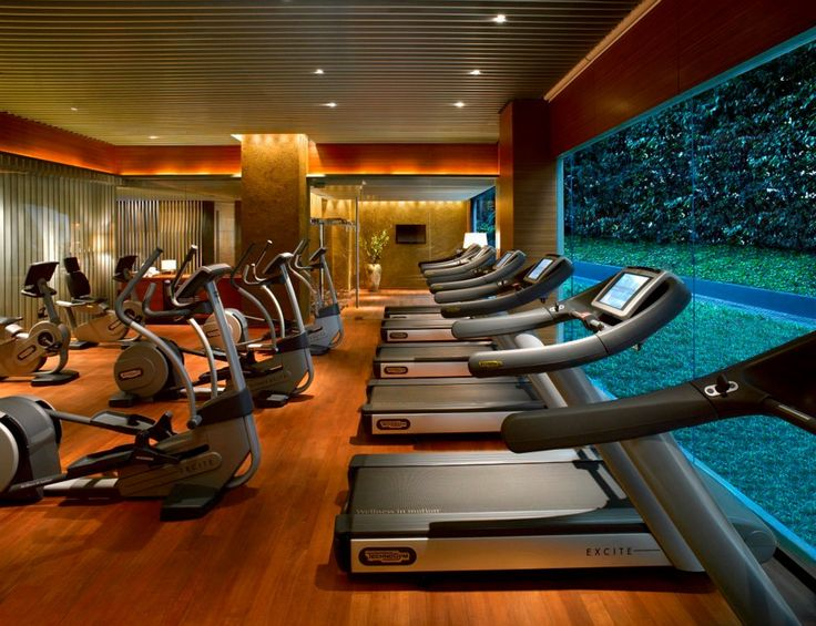 The sleek Fitness Centre at the Grand Hyatt Singapore features Kinesis Stations and personal trainers on standby for safe, accessible workouts for all guests.