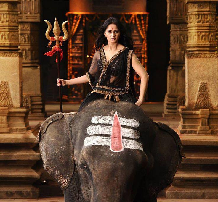 indian actress anushka shetty riding bareback on an