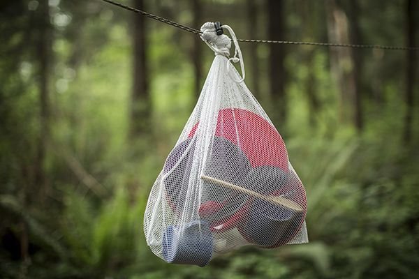 Camp Cooking Hack #3: Dishes: a tedious chore at home and no better out in nature. Hang a mesh bag from a tree and put freshly washed dishes inside to air dry.