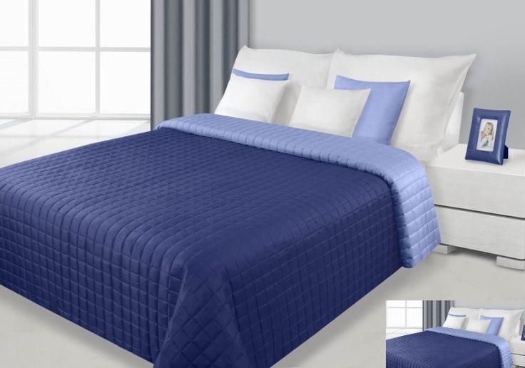 Narzuta dwustronna na łóżko w kolorze granatowo niebieskim