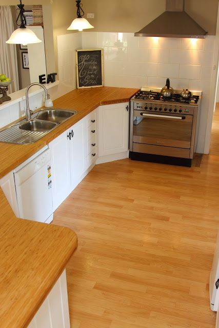 NZ Kitchen Makeover. Bamboo benchtops, standalone cooker, white tiles and doors.