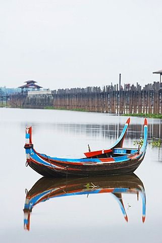 Colourful boat and U Bein Bridge on Taungthaman Lake, Amarapura, Mandalay…