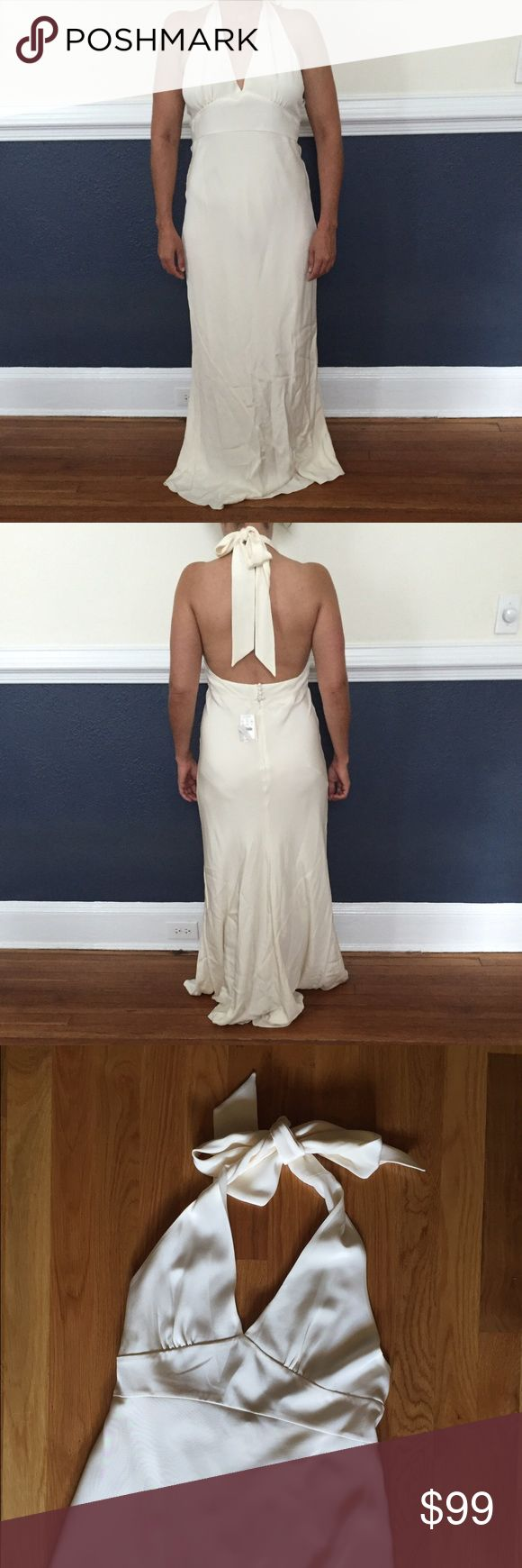 J. Crew halter top wedding dress Gorgeous J. Crew halter top wedding dress in lined ivory silk. Purchased at outlet sale; NWT. (Has been stored in a dust bag so the bottom is quite wrinkled - sorry!) J. Crew Dresses Wedding
