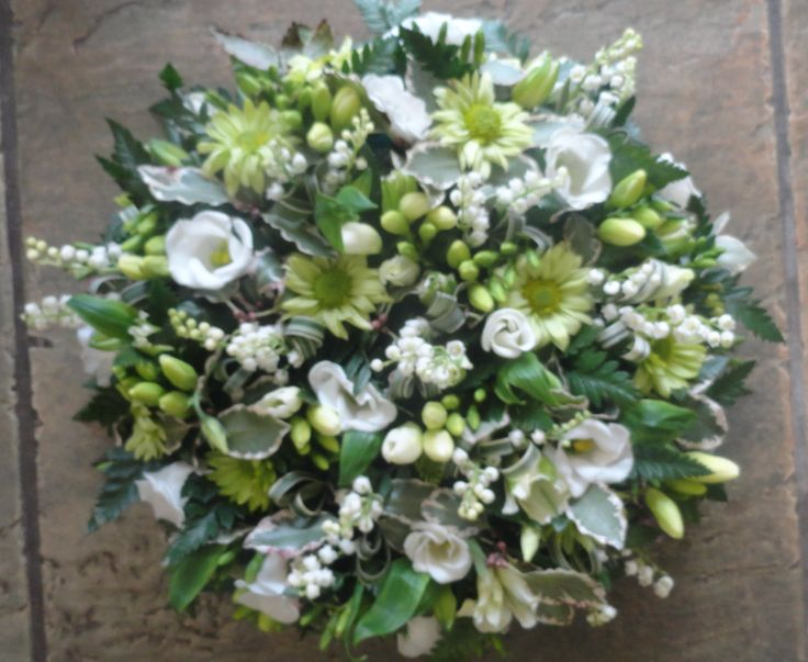 Green and white loose style posy pad, including Lily Of The Valley.
