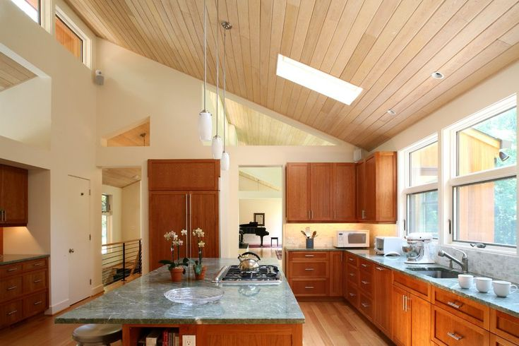 Cathedral ceiling kitchen kitchen modern with clerestory windows wood panel ceiling under cabinet lighting