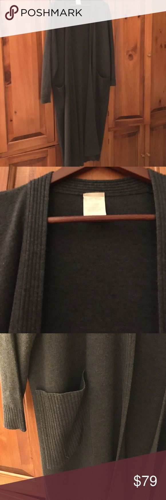 Charcoal grey wool duster/long cardigan 2X Great quality merino wool and acrylic open front. duster. Long sleeves. Two patch pockets. Ribbed trim all around and down the front, on pockets, and cuffs. Pristine condition. Bought at Saks Fifth Avenue. Made in Italy. 49.5 inches long. Generous draped sizing. 27 inches armpit to armpit although the front is open/ no buttons or fastenings. Great transitional sweater coat. Stizzoli Sweaters Cardigans