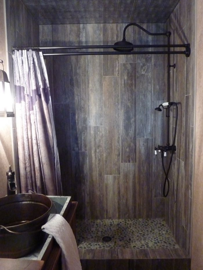 Master Bathroom Transformed With Reclaimed Wood Tile River pebble shower floor, shower curtain is in wood print, I really like the look of wood tiles.