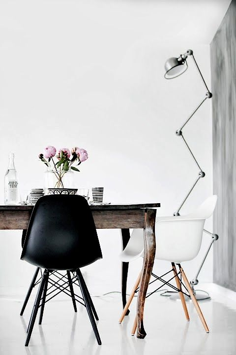 dining room /// b+w eames around an old wooden table / industrial floor lamp / one charcoal wall