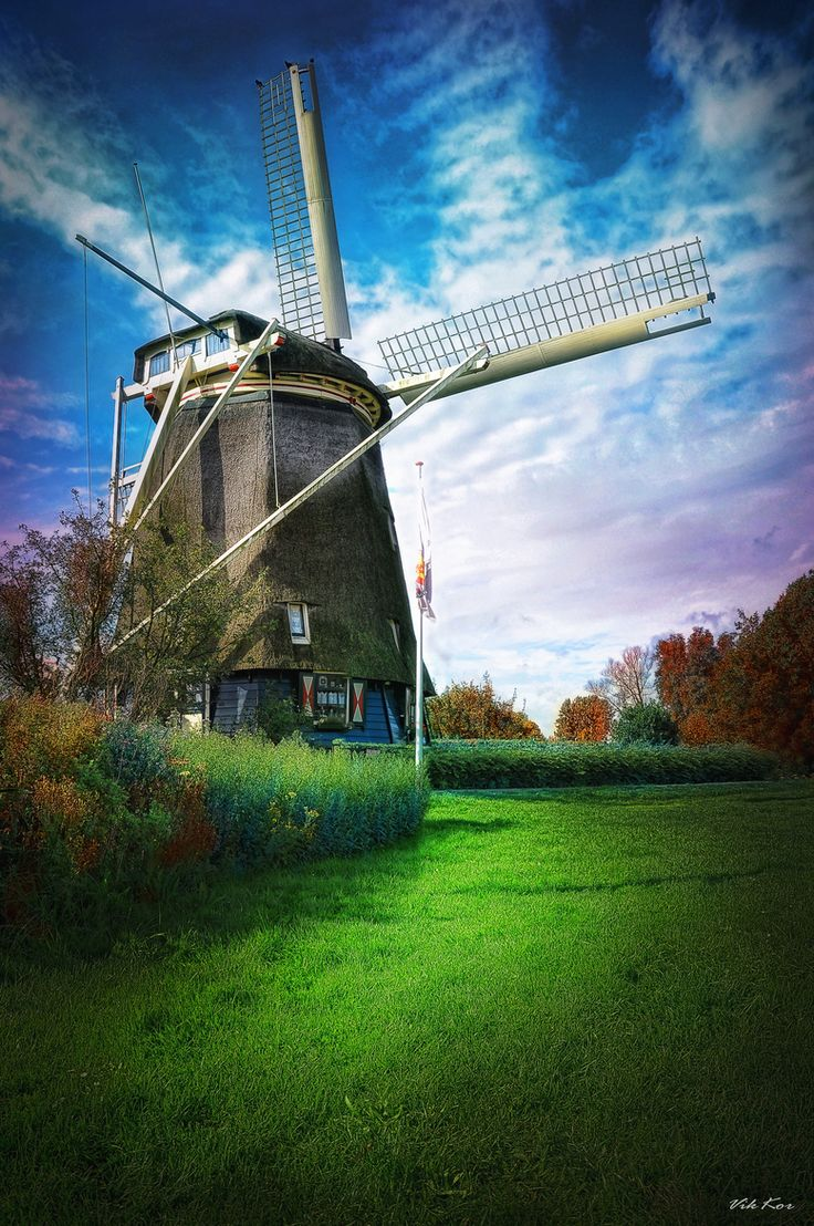 Windmill.Holland - in a country which used to have hundreds....they now only have 80 working windmills.....I got to see one that still saws wood