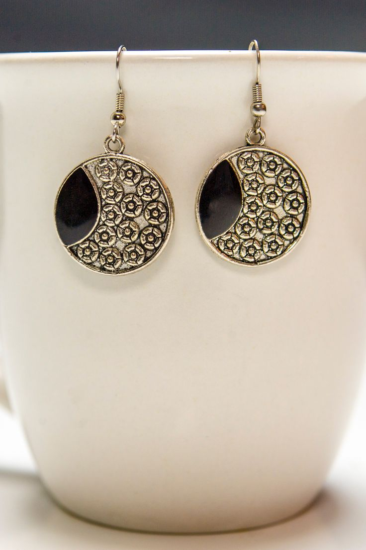 Flower Engraved Silver Earrings With Black Accents