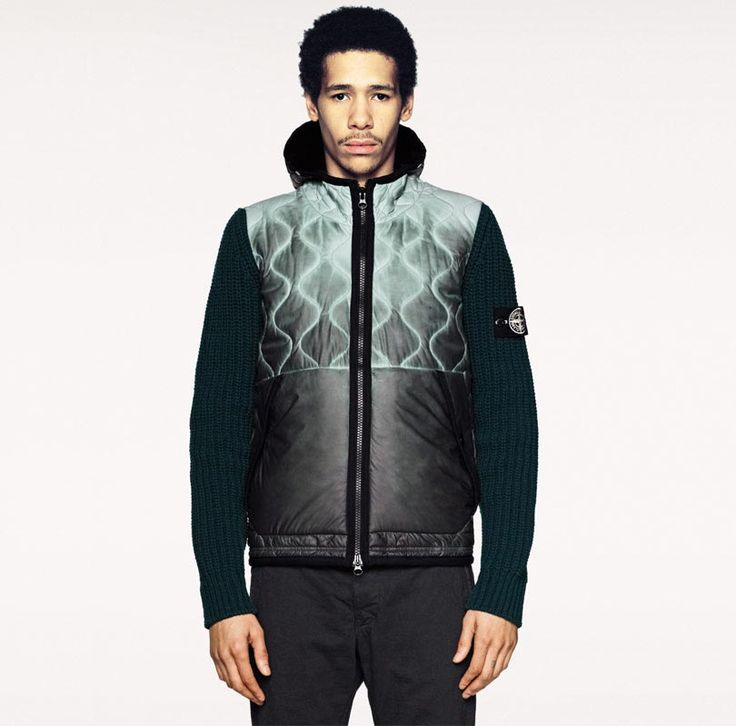 Stone Island released a new jacket in 2013 which changed colour according to the temperature. The jacket goes from a light grey to a dark grey. Thermo-sensitive materials have been used. A water- and wind-resistant polyurethane film is embedded with micro-encapsulated pigments. The molecules of the pigments change the transition of light and colour in relation to the temperature changes also. http://www.stoneisland.com/experience/en/stone-island-aw013-ice-jacket-j/