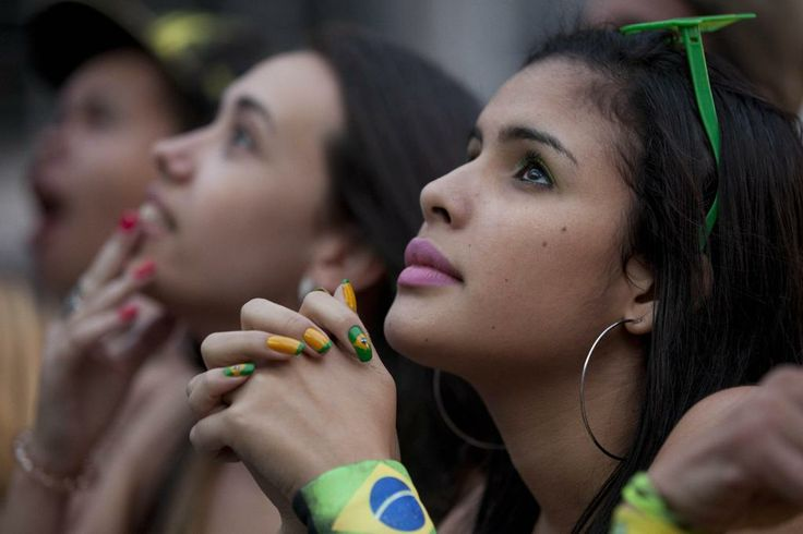 Fans watch a live telecast of the Mexico vs. Brazil match at the FIFA Fan Fest during the 2014 soccer World Cup in Sao Paulo, Brazil, Tuesday, June 17, 2014. Mexico claimed a deserved point against Brazil in a largely frustrating Group A game which finished 0-0 at Estadio Castelao in Fortaleza. (AP Photo/Dario Lopez-Mills)