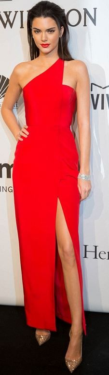 Who made  Kendall Jenner's red one shoulder gown and crystal nude pumps that she wore in New York on February 11, 2015?