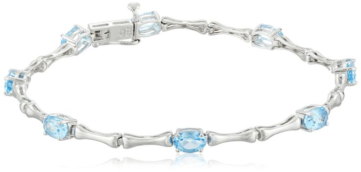 """Sterling Silver Blue Topaz Bracelet, 7.5"""". Sterling silver bracelet with bamboo-inspired links featuring seven prong-set oval Blue Topaz gemstones. Gemstones may have been treated to improve their appearance or durability and may require special care. The natural properties and composition of mined gemstones define the unique beauty of each piece. The image may show slight differences to the actual stone in color and texture. Blue Topaz is December's birthstone. Imported."""