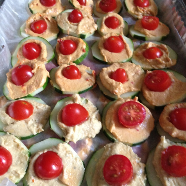 Cucumber, roasted red pepper hummus, cherry tomatoes- easy healthy party app I made up myself