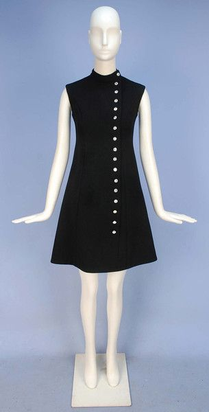 NORMAN NORELL LITTLE BLACK DRESS with RHINESTONE BUTTONS, 1960's. Sleeveless wool A-line with princess seams having stand collar and off center column of large rhinestone buttons, silk lining. Labeled, inked ribbon numbered 129-46-115-8. B-32, W-28, H-34, L-36. Excellent. $780.
