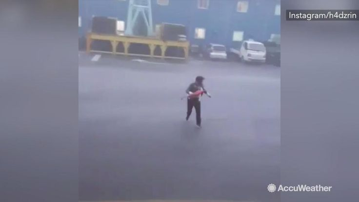 Oct 6, 2016; 8:40 AM ET Workers from a shipyard in Busan, South korea are seen running for safety as gusty winds and heavy rain from Chaba hit the area on Oct. 5.