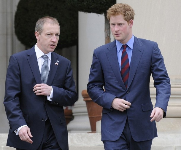 Britain's Prince Harry (R) walks with Foundation of Prince William and Prince Harry CEO Nick Booth (C) as they arrive for a garden reception with wounded U.K. service members at the British Embassy in Washington, May 7, 2012. The service personnel are members of Britain's team for the Warrior Games, an event hosted every year by the U.S. Olympic Committee in which injured veterans compete in Paralympic-style sporting events.