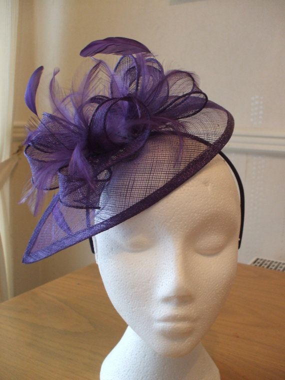 Cadburys Purple Fascinator and Feather Fascinator on a hairband, races, weddings, special occasions. £30.00, via Etsy.