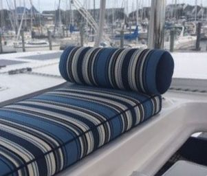 "customer's relaxing sailboat cushions | ""Here are the cushions that were done for our Leopard 48 catamaran. The accent pillows look great and the bench seat cushion and bolster allow for someone to sit behind the captain and watch the boat steering and sail management."" Featured Fabrics: Outdura Tradewinds Nautical & Outdura Scoop Sapphire"