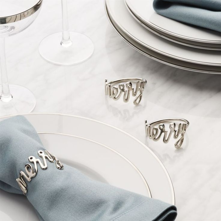 """Shop Merry Napkin Ring. Contemporary napkin ring spells out """"Merry"""" in a flowing, silvery script."""