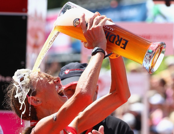Chrissie Wellington of England enjoys a glas of weissbier after winning the Challenge Roth Triathlon with a new long distance world record on July 10, 2011 in Roth, Germany.