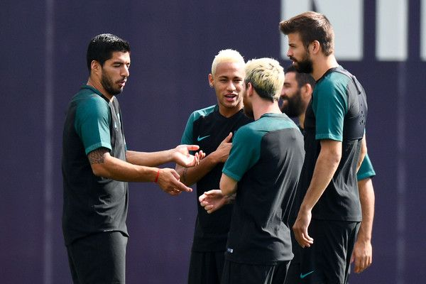 (L-R) Luis Suarez, Lionel Messi, Neymar Jr. and Gerard Pique of FC Barcelona share a joke during a training session ahead of their UEFA Champions League Group C match against Celtic FC at Ciutat Esportiva of Sant Joan Despi on September 12, 2016 in Barcelona, Catalonia.