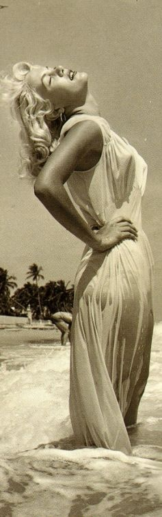 unbelievably beguiling Marilyn Monroe in wet white beach dress – truly living up to her bombshell Sex Goddess name – rather sex symbol, since she was still innocent but ever so charming...