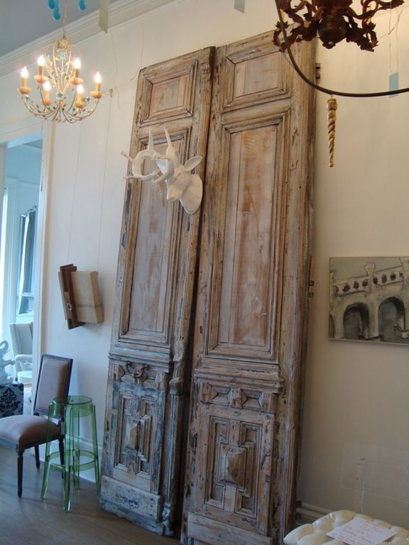 Beautiful old doors bring patina style to a contemporary space. This pair is tall and stunning.