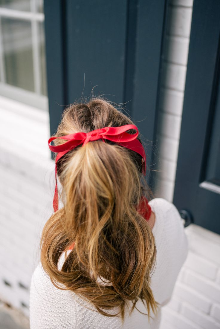 Gal Meets Glam Holiday Red - High pony tail & red ribbon for the holidays.