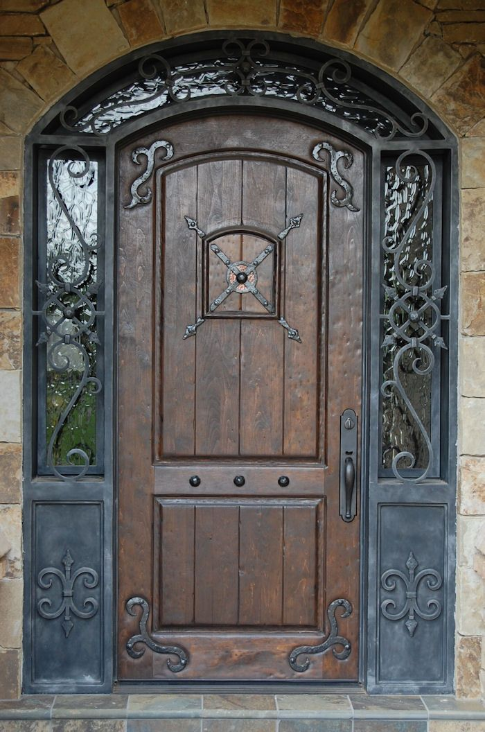 I love the large oversized front door that have a mix of wood, iron and windows.