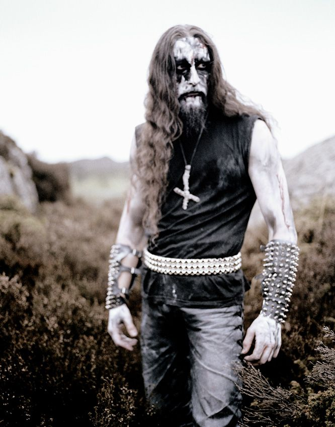 Norwegian black metaller, in a field.