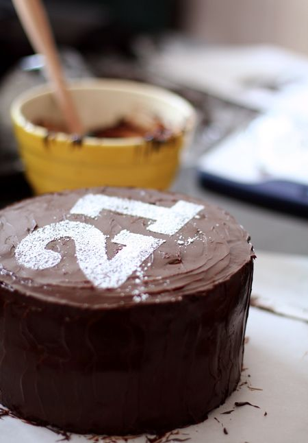birthday cake with number stenciled with powdered sugar